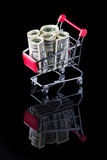 Cart with money. Royalty Free Stock Photo