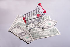Cart with money. Royalty Free Stock Images