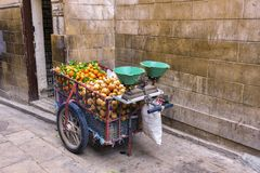 A cart by a Moroccan street fruit vendor equipped royalty free stock images