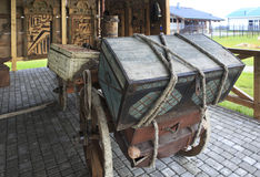 Cart with the old trunk. Peasant Museum in Tourist Complex Siberian Podvorye. Stock Photos