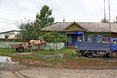A cart with one horse and an old soviet lorry parked in front of Stock Photos