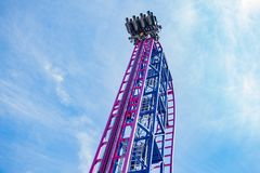 Roller coaster ride on a sunny day royalty free stock photography