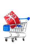 Cart with red gift box Royalty Free Stock Photos