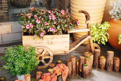 Cart shape wood garden pot Stock Image