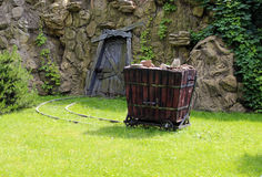 Cart with stones. At the entrance to the mine - stylization Royalty Free Stock Photos