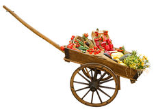 Cart with vegetable isolated on white royalty free stock photography