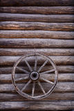 Cart wagon old wheel on wall Royalty Free Stock Images