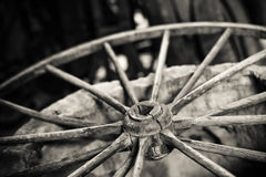 Cart wheel. Vintage wagon cart wheel with decaying wooden spokes Stock Image