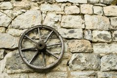 Cart wheel. A cart wheel and an old stone wall Stock Photo