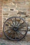Cart Wheel. Old Cart Wheel and stone wall Royalty Free Stock Image