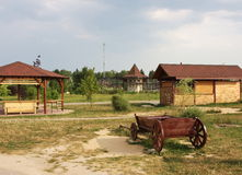 Cart and wooden arbours, on a green glade. In a summer park Stock Photos