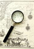 Carta antigua del mar, lupa Foto de archivo libre de regalías