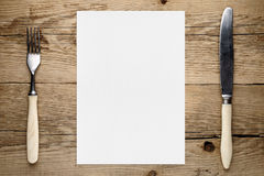 Carta in bianco per il menu e forcella e coltello Immagini Stock