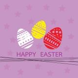 Carta con la porpora del fondo delle uova di Pasqua e della stella Fotografie Stock