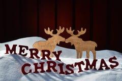 Carta con memorabile, coppia delle alci, Buon Natale della neve fotografia stock