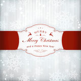 Carta d'argento dell'invito di Natale con l'etichetta Fotografia Stock