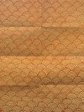 Carta da imballaggio arancio con le onde disegnate a mano geometriche Fotografia Stock