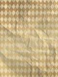 Carta da imballaggio con i rombi dell'oro Immagini Stock