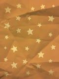Carta da imballaggio d'annata gialla con le stelle Fotografia Stock Libera da Diritti