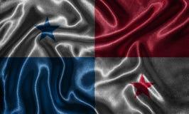 Carta da parati dalla bandiera del Panama e dalla bandiera d'ondeggiamento da tessuto immagini stock libere da diritti