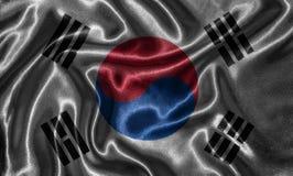 Carta da parati dalla bandiera della Corea del Sud e dalla bandiera d'ondeggiamento da tessuto immagine stock libera da diritti