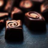 Carta da parati dolce di Candy di cioccolato nell'alta risoluzione Chocola scuro Fotografia Stock