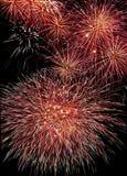 Carta da parati rossa dei fuochi d'artificio Fotografia Stock