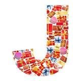 Carta de J hecha de giftboxes Fotografía de archivo