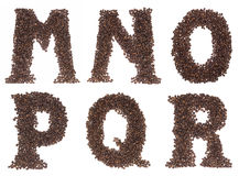 Carta del alfabeto hecha de los granos de café Foto de archivo