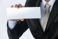 Carta della tenuta dell'uomo d'affari Immagini Stock