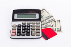 Carta di credito, banconote in dollari e calcolatore Immagini Stock