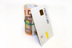 Carta di credito dei soldi e del rullo Fotografie Stock Libere da Diritti