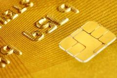 Carta di credito di plastica dorata Immagine Stock