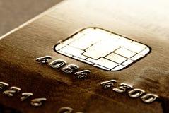 Carta di credito dorata fotografie stock