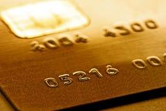 Carta di credito dorata Immagine Stock