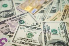 Carta di credito e dollari Immagine Stock