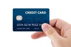 Carta di credito di plastica della tenuta della mano Immagine Stock