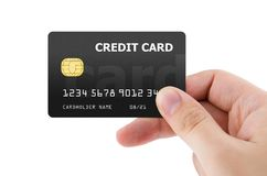 Carta di credito di plastica della tenuta della mano Immagini Stock