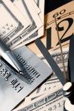 Carta di credito, tempo e dollari di contanti Fotografie Stock Libere da Diritti