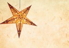Carta di festa con la stella e la carta Fotografia Stock