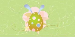 Carta di pasqua con l'uovo ed i fiori fotografia stock