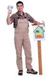 Carta do uso eficaz da energia da terra arrendada do trabalhador Imagem de Stock Royalty Free