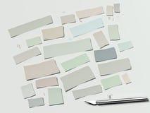 Carta e bisturi cutted colorati su un fondo bianco rappresentazione 3d Immagini Stock Libere da Diritti
