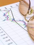 Carta e vidros de negócio Fotos de Stock