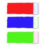 Carta lacerata con rosso, il blu ed il verde Fotografie Stock
