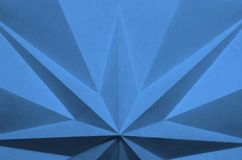Carta piegata a forma di stella come fondo astratto immagine stock