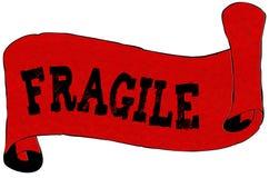Carta rossa del rotolo con testo FRAGILE Fotografia Stock Libera da Diritti