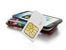 Carta SIM con gli smartphones Fotografie Stock