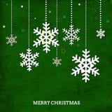Carta verde del vintage con los copos de nieve de la Navidad y o stock de ilustración