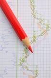 Carta vermelha do lápis e do estoque Fotografia de Stock
